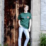 rusty door senior portrait boy
